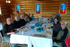 Rockjumper's 2019 Alaska birding tour group enjoying a celebratory dinner at Tonglen Lakes Lodge