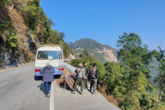 Rockjumper's 2020 Bhutan birding tour group having a tea break on the side of the road high in the mountains