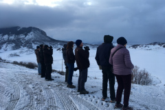 Rockjumper's 2019 Colorado birding tour group searching for Sharp-tailed Grouse in the snow