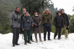 Rockjumper's 2020 Bhutan birding tour group take a group photo in the snow