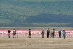 One of Rockjumper's Kenya birding tour groups enjoying the spectacle of thousands of flamingos at Lake Nakuru