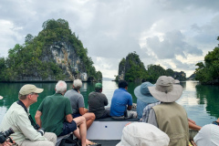 Rockjumper's 2019 Remote West Papuan Islands birding tour group cruising between smaller islands