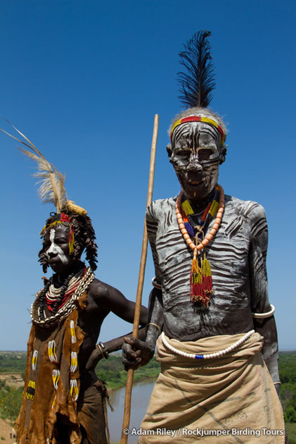 An elderly Karo couple with the Omo River in the background