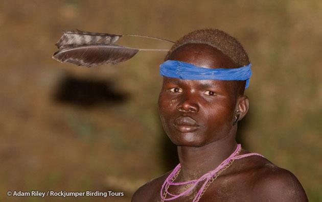 A Mursi cattleherder sports a Pennant-winged Nightjar headgear